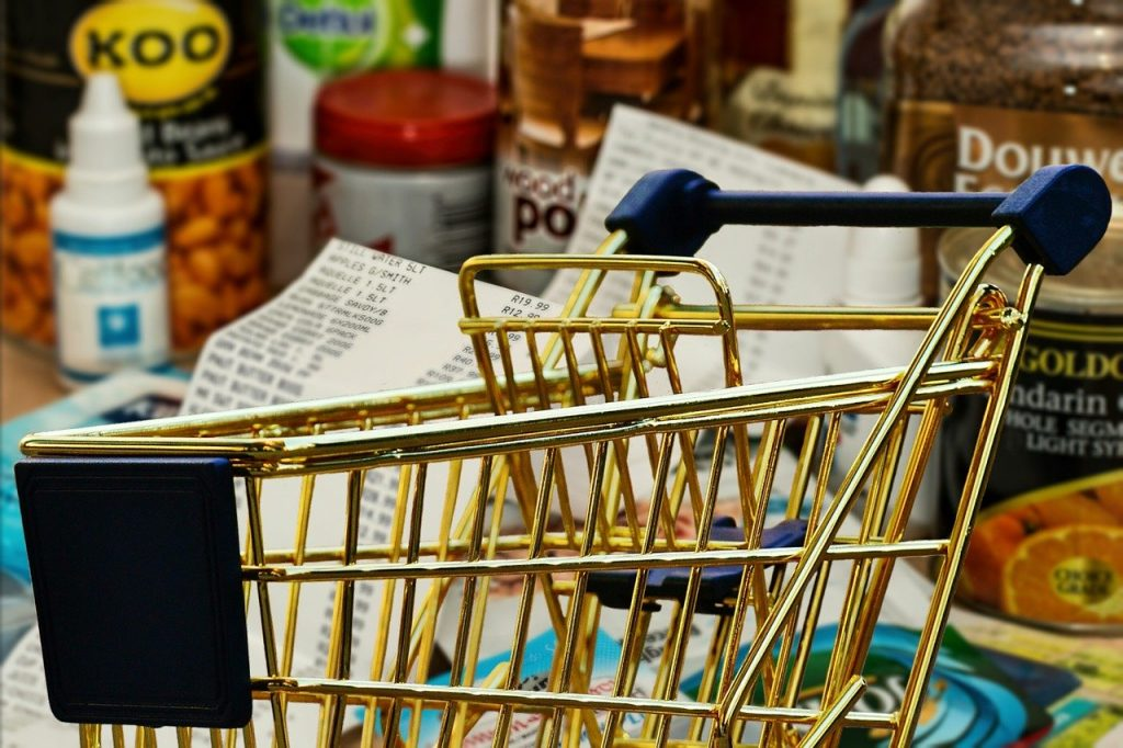 A shopping trolley in front of groceries