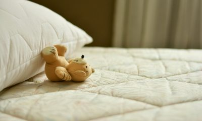 A new mattress with a teddy bear on top