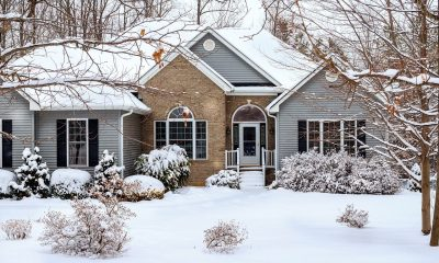 A house in the snow with vinyl siding on the walls