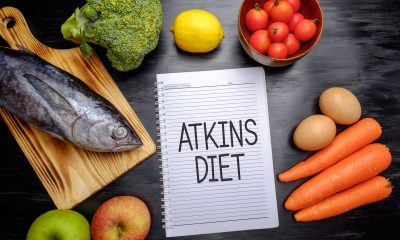 Atkins diet written on paper next to food