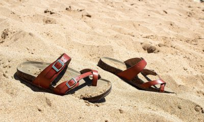 A pair of Birkenstocks on the beach