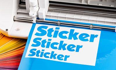 A Cricut machine cutting stickers