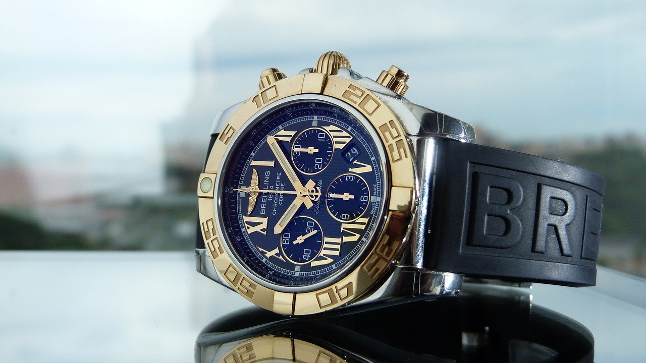 A gold and blue Breitling watch