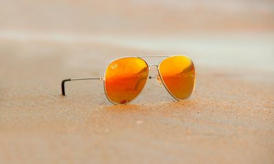 A pair of Ray-Bans on the beach