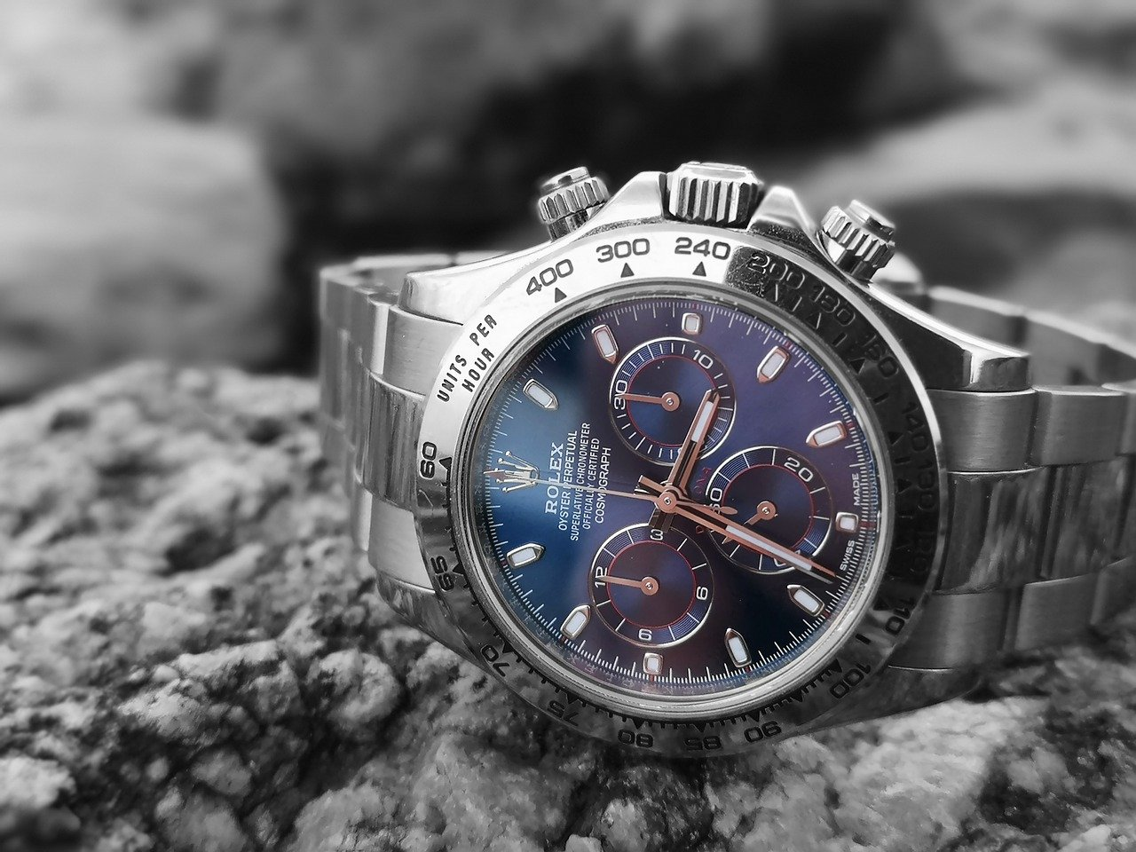 A Rolex on top of a rock