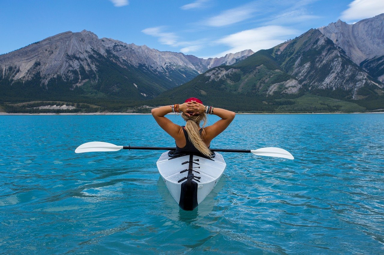 A woman sat in a kayak on the water