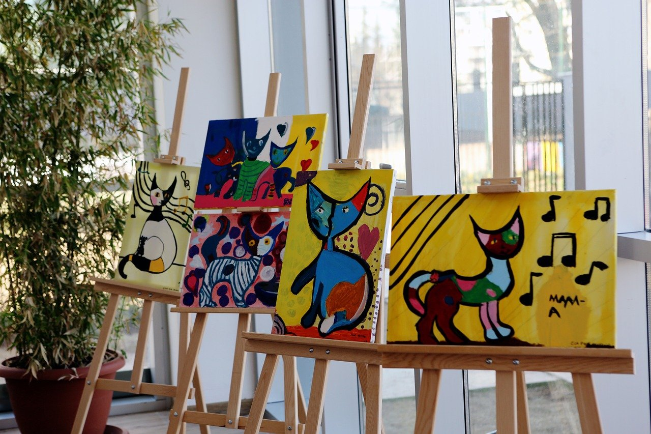 Four pieces of art on easels