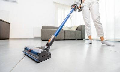 A woman vacuuming the carpet