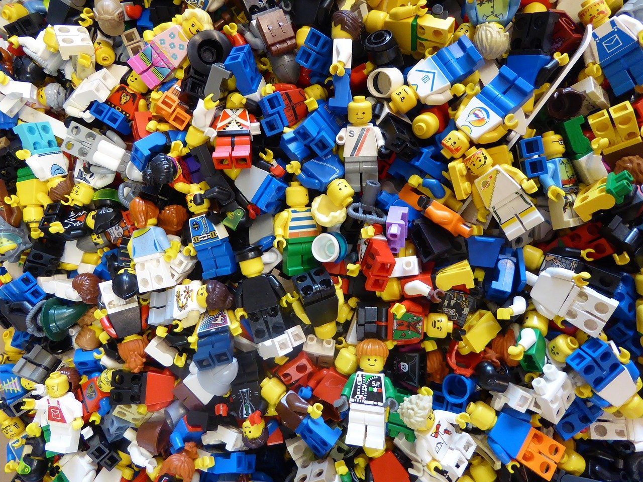 Many Lego men in a pile
