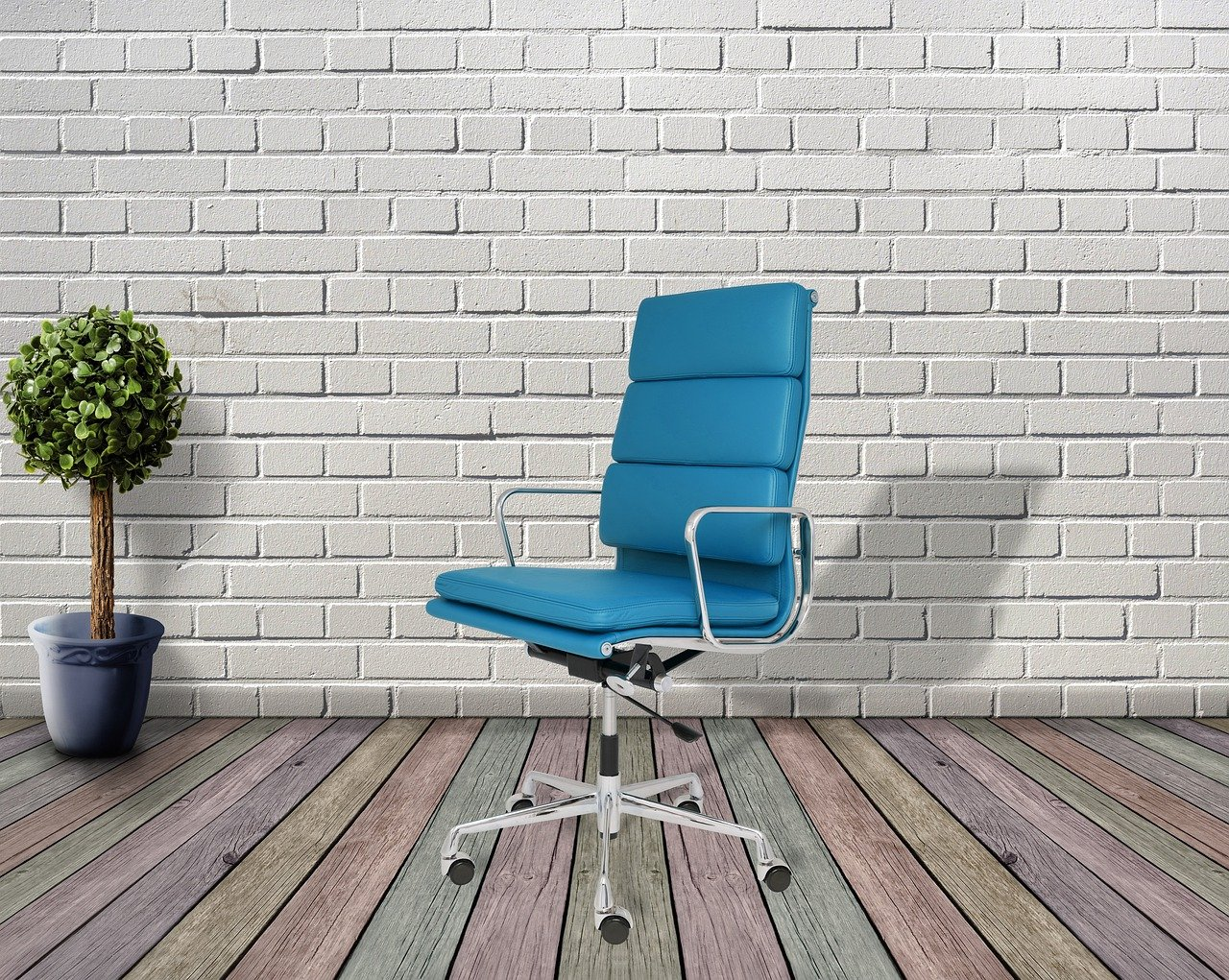 A blue office chair on a wooden floor