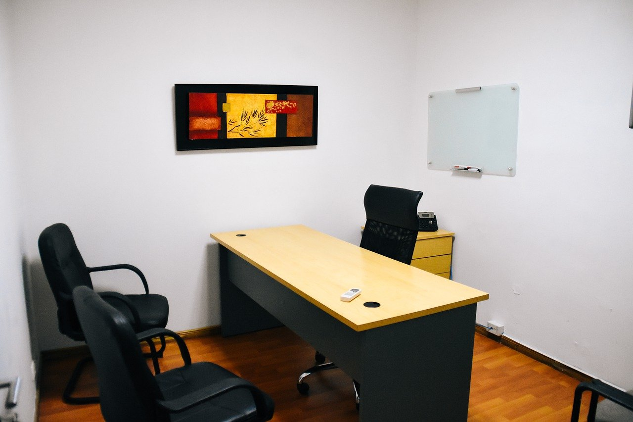 An office with desk and chairs