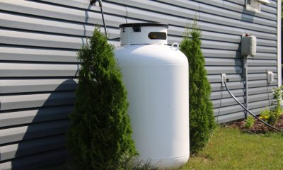 A propane tank outside a house