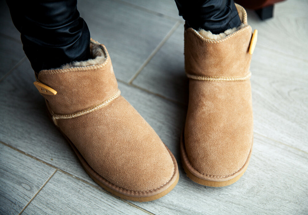 A woman wearing Ugg boots