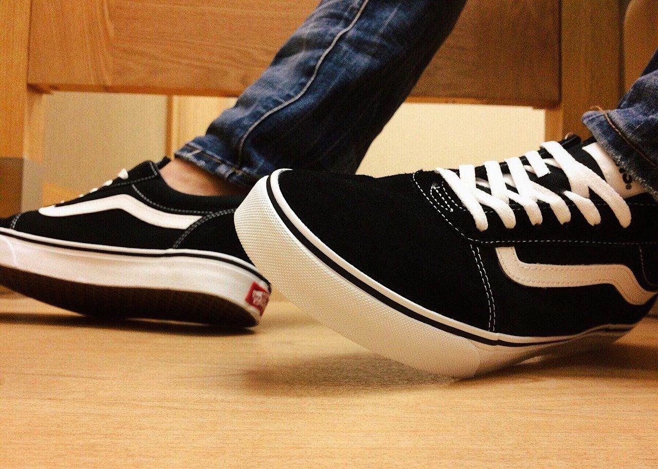 A pair of Vans shoes