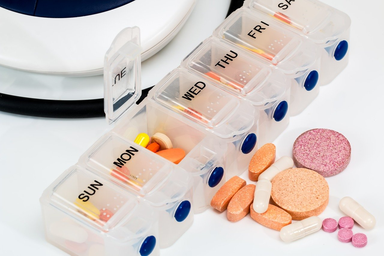 Vitamin supplements in a day of the week pill box