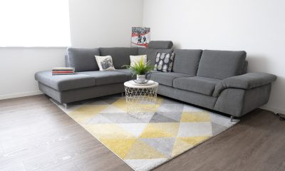 A rug in front of a couch