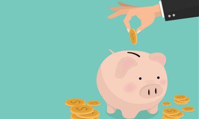 A man putting money into a piggy bank