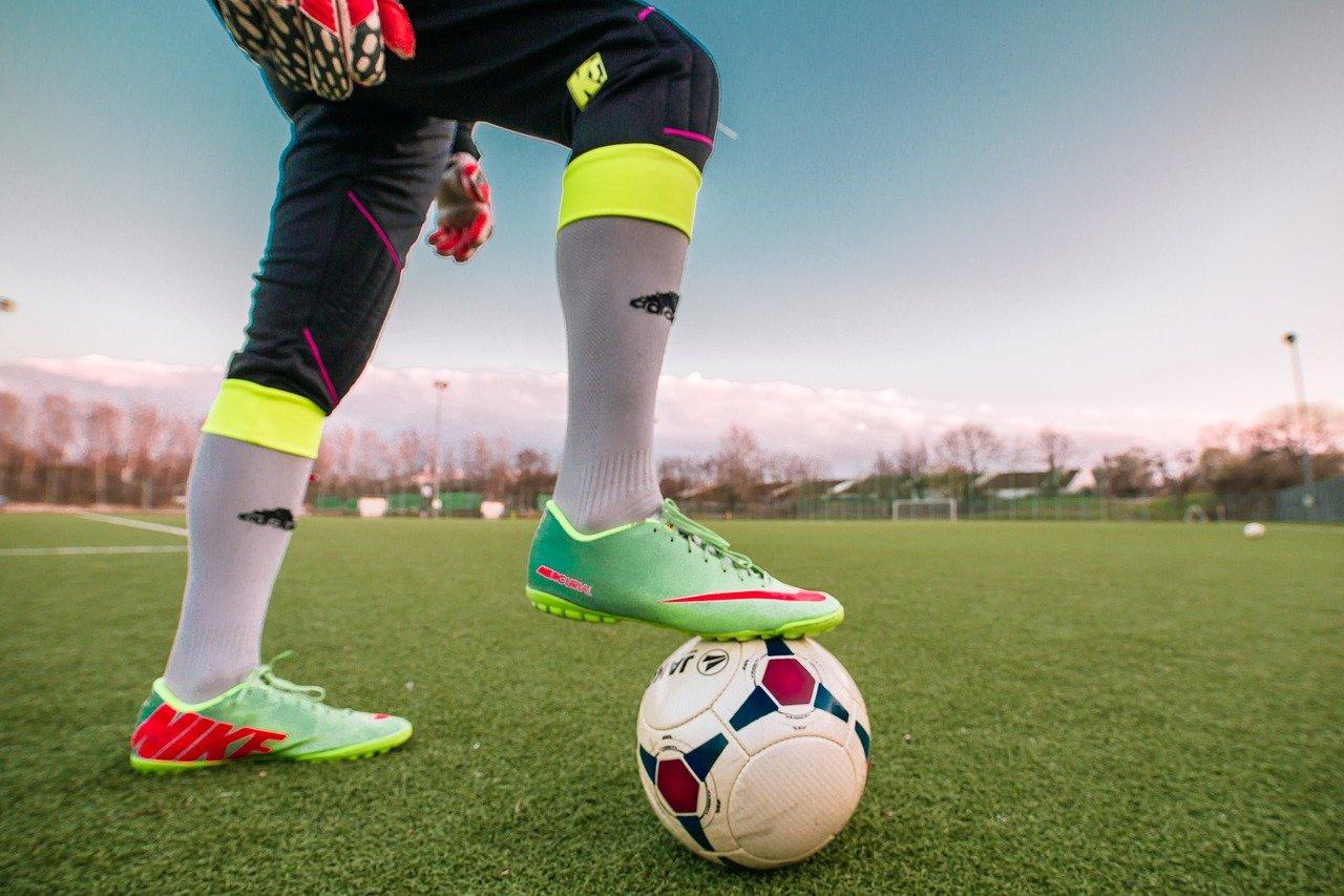 A footballer wearing soccer boots