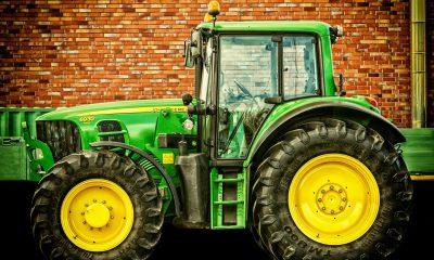 A green tractor with large tires